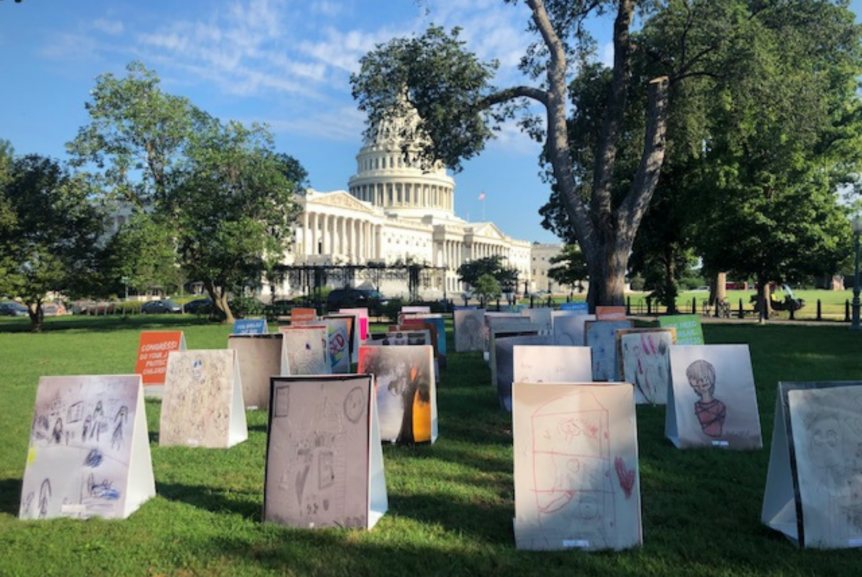 art installation of kids' art in front of Congress