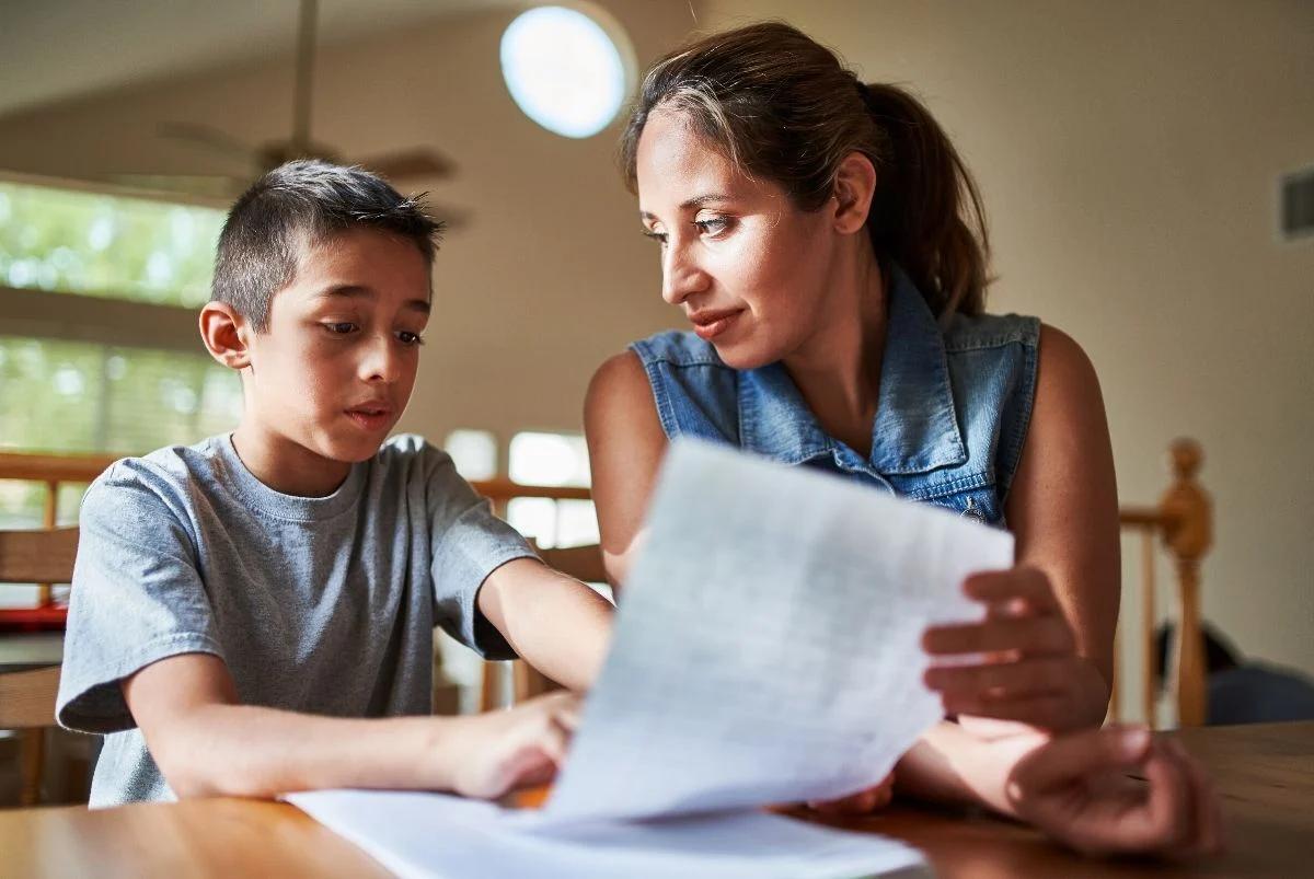 Mom helping son do homework.